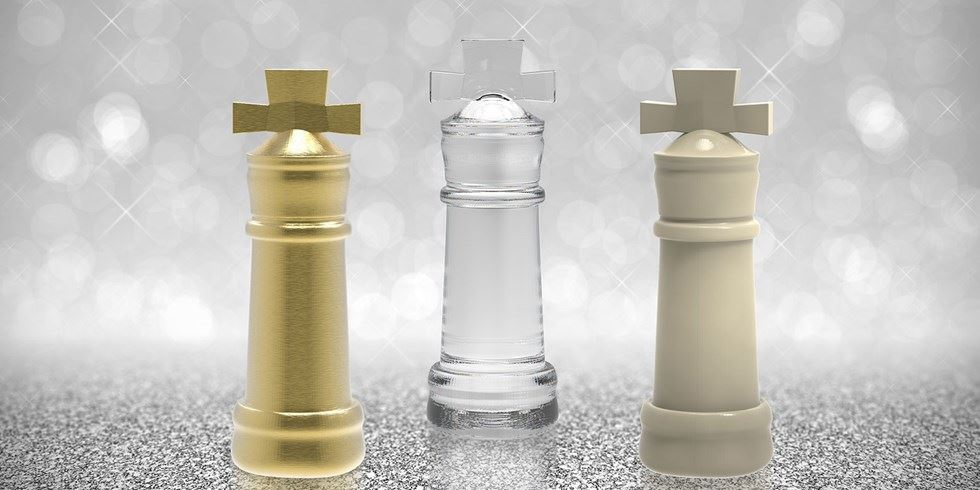 Gold silver bronze chess pieces