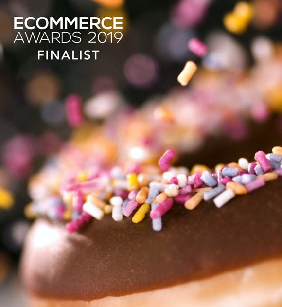 Doughnut with sprinkles with ecommerce awards logo
