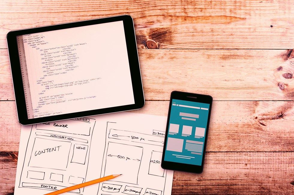 Wireframes for website with a mobile and ipad
